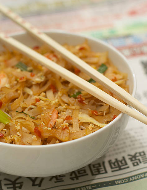 Chinese food on asian newspaper. stock photo
