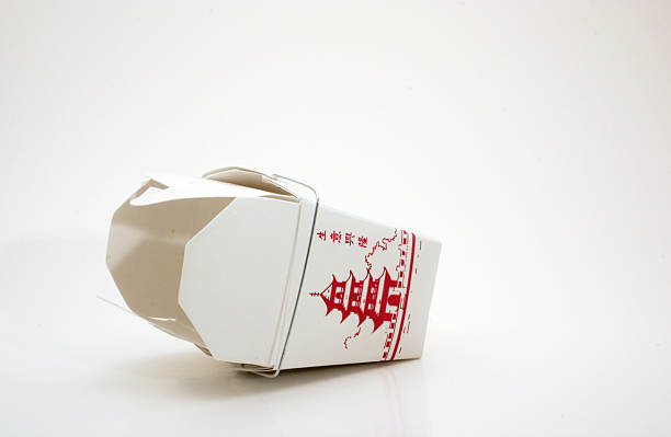 Chinese food (empty) Empty and overturned generic take out box from Chinese fast food restaurant...late night snack. chinese takeout stock pictures, royalty-free photos & images