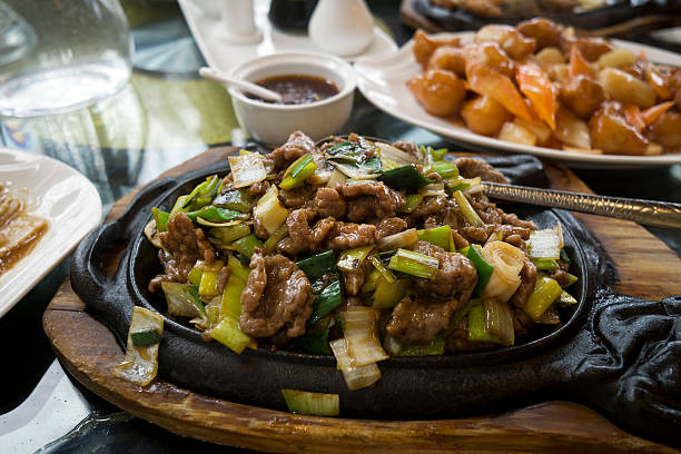 Chinese food with beef. Chinese food - stir fry beef with vegetables sauce. mongolian culture stock pictures, royalty-free photos & images