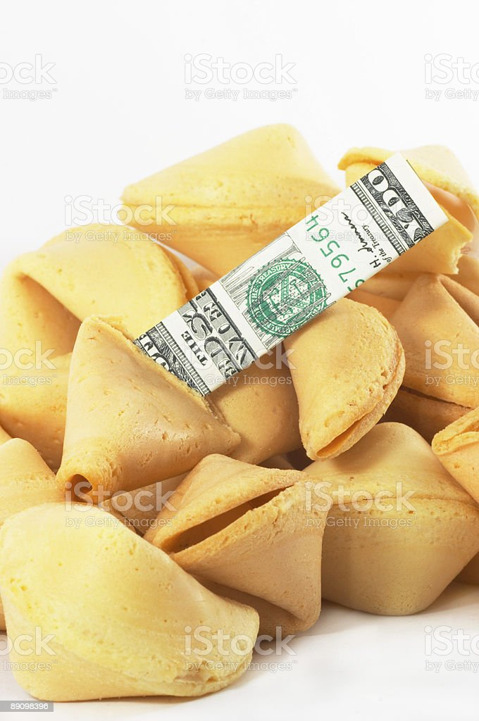 Chinese Fortune Cookie open with money, cash, on white backgrou royalty-free stock photo