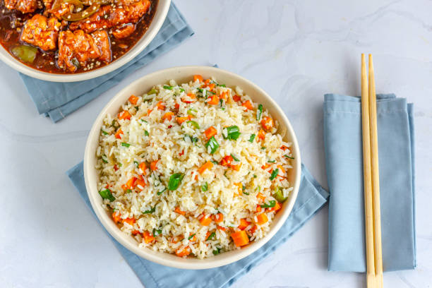 "Chinese Fried Rice with Chicken Side Dish Directly Above Photo Chinese Vegetable Fried Rice in a Bowl with SIde Dish Top View Photo. Vegetable Fried Rice with Chicken Side Dish Top View Photo.""n fried rice stock pictures, royalty-free photos & images"