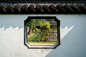 Chinese garden: window and wall,  photographed in a free public park named Xiyuan,  Yangzhou city, China.