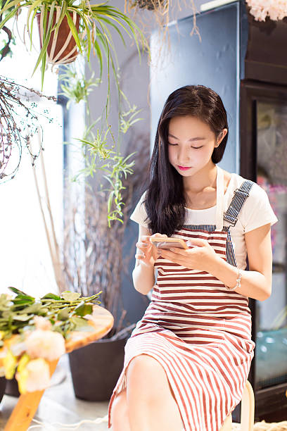 chinese girl and her beautiful flowers stock photo