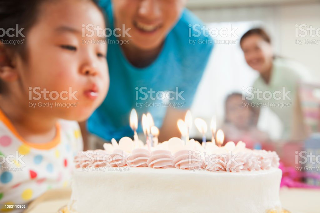 Awesome Chinese Girl Blowing Out Candles On Birthday Cake Stock Photo Funny Birthday Cards Online Inifofree Goldxyz