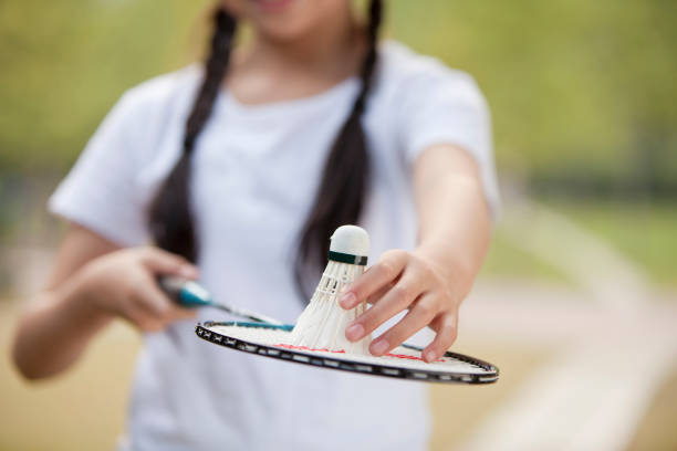 Chinese girl holding badminton racket and shuttlecock stock photo