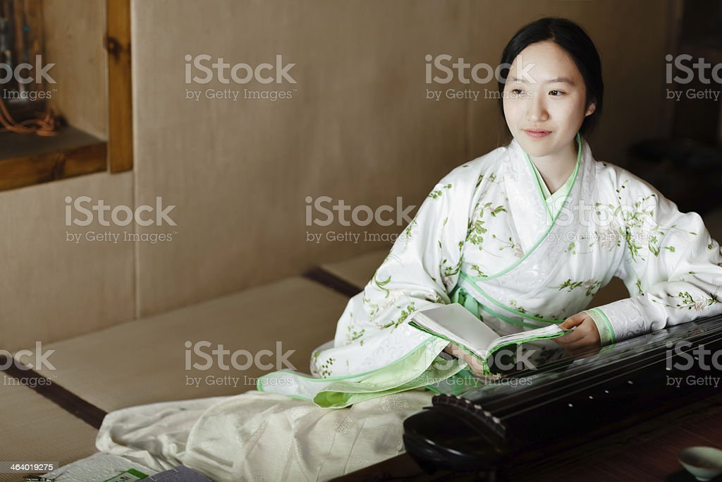 Chinese girl reading the old book royalty-free stock photo