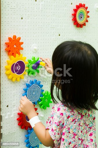 514261930 istock photo Chinese girl solving puzzle 485455658