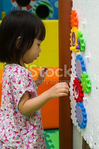 514261930 istock photo Chinese girl solving puzzle 485455700