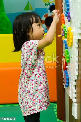 514261930 istock photo Chinese girl solving puzzle 485455916