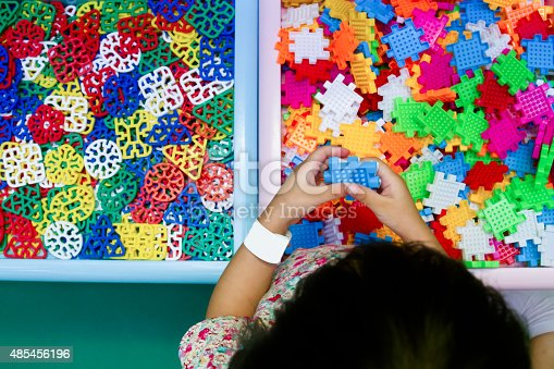 514261930 istock photo Chinese girl solving puzzle 485456196