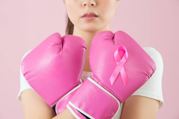 Chinese girl wear boxing gloves crossed arms stock photo