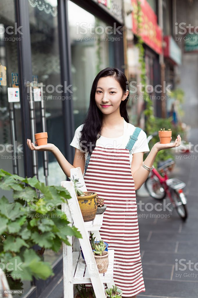 chinese girl wearing an apron stock photo