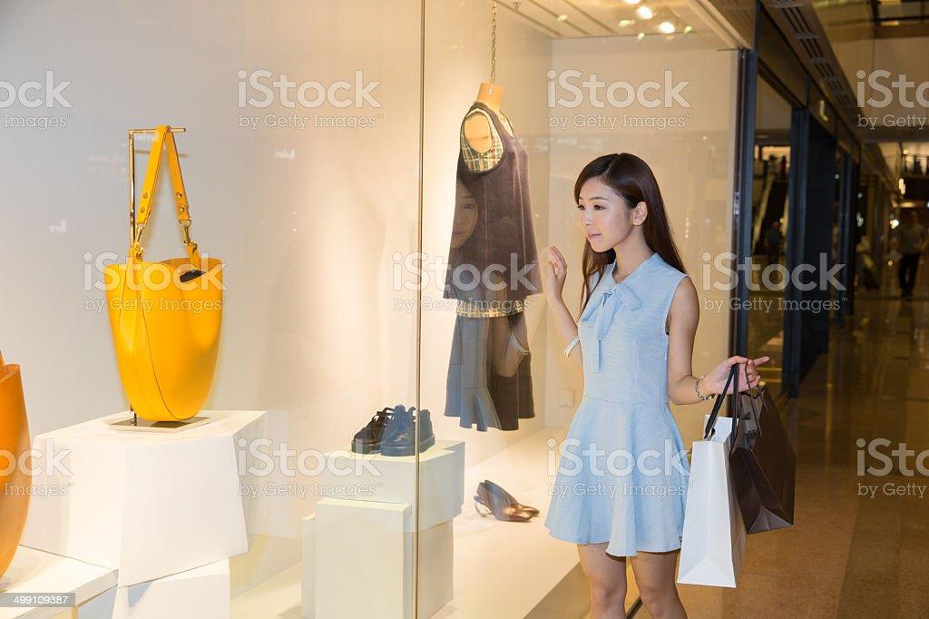 Chinese girl window shopping stock photo