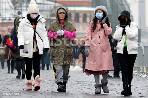 Moscow, Russia - January 2020: Chinese girls walking on a Red square in Moscow. Asian tourists in Russia