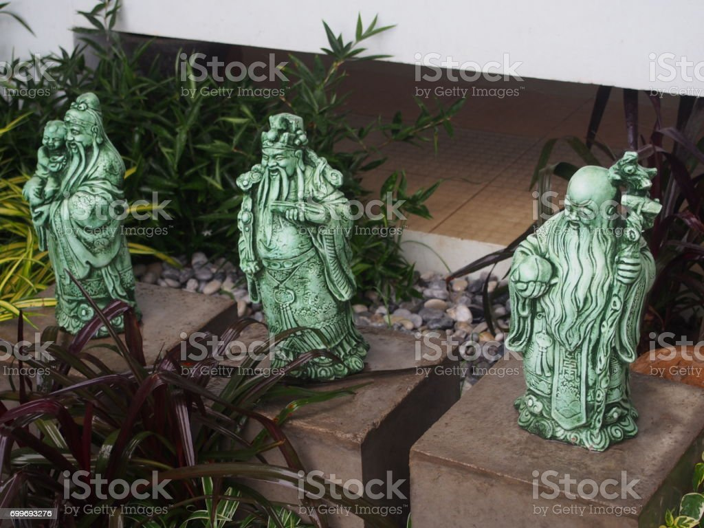 Chinese god of fortune, prosperity and longevity figurine called three goddesses Fu Lu Shou in the small garden stock photo