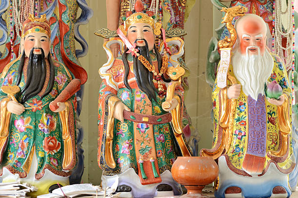 Chinese Gods Shou Fu and Lu ceramics sculpture in temple stock photo