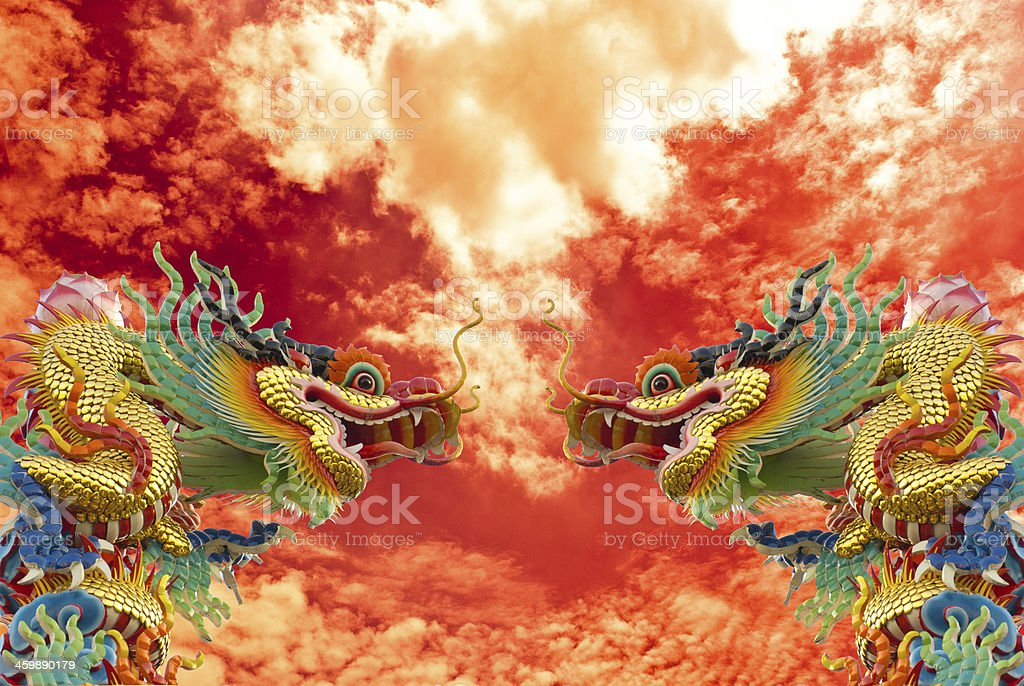 Chinese golden dragon with column and sky background,2012 stock photo