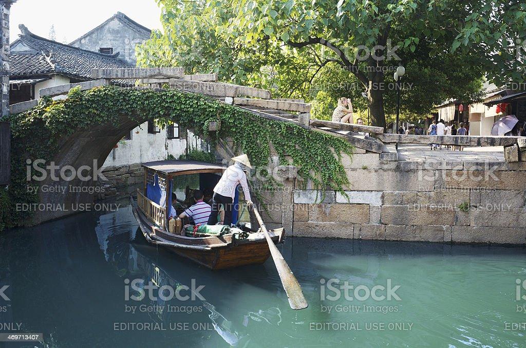 Chinese gondola boat sightseeing trip under Twin Bridges in Zhouzhuang royalty-free stock photo