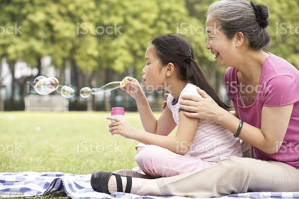 Chinese Grandmother With Granddaughter In Park stock photo