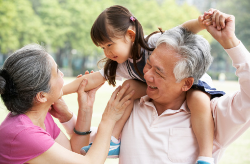istock Chinese Grandparents Giving Granddaughter Ride On Shoulders 178642900