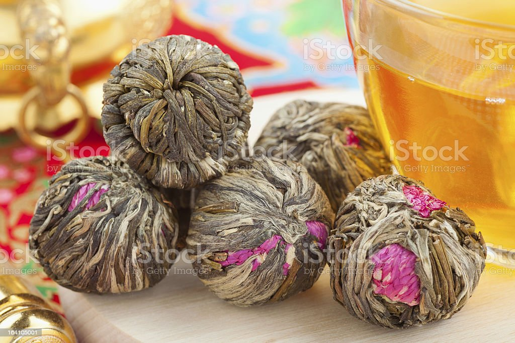 Chinese green tea balls with flowers royalty-free stock photo
