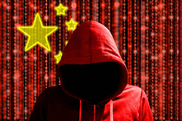 Chinese hacker in front of digital datastream flag stock photo