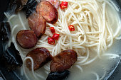 Chinese handmade noodles:sausage stock soup noodles