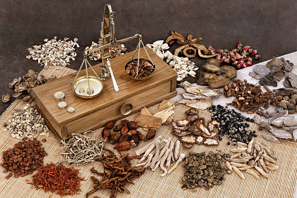 Chinese Herb Ingredients Traditional chinese herbal medicine selection with herb ingredients and old scales. chinese herbal medicine stock pictures, royalty-free photos & images