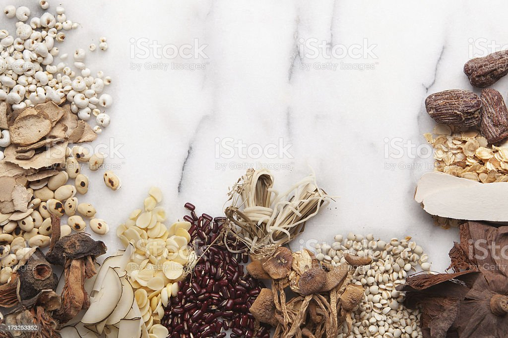 Chinese Herbal Medicine Remedy Ingredients on Marble with Copy Space royalty-free stock photo