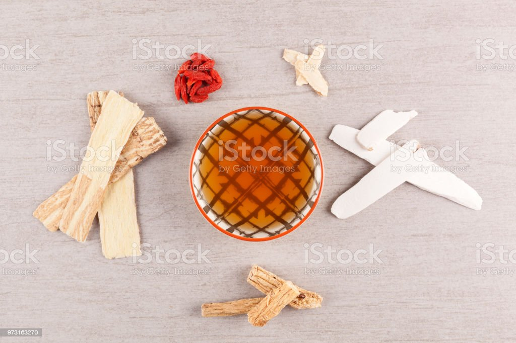 Chinese herbal medicine soup with ingredient from above. stock photo