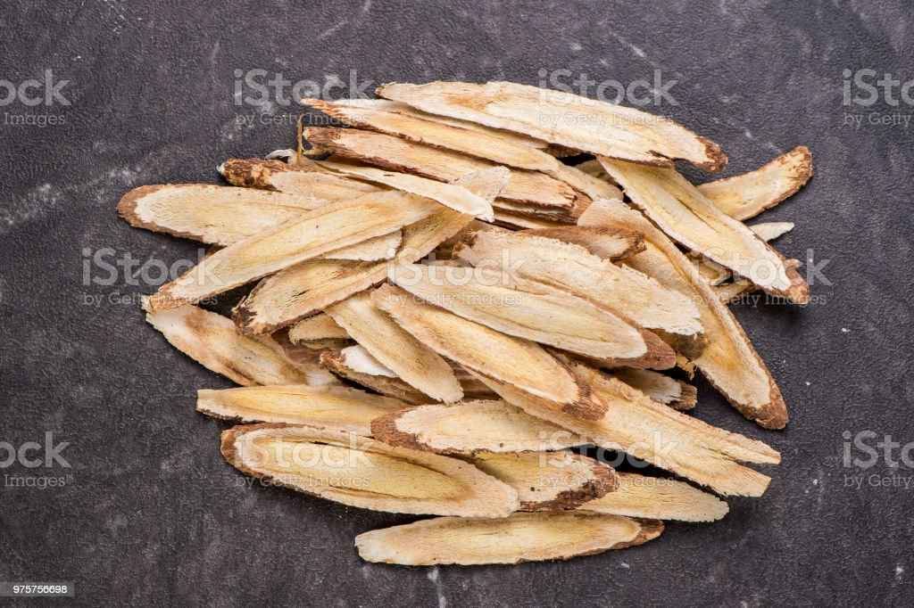 Chinese herbal medicines -- Astragalus on stone background, blank for text, copy space stock photo