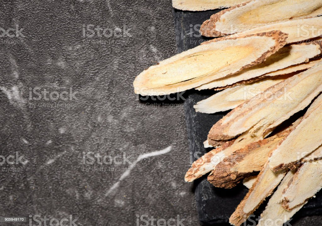 Chinese herbal medicines -- Astragalus on stone background stock photo