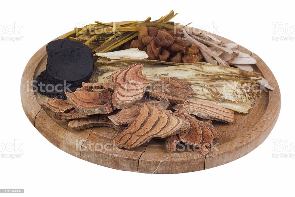 Chinese herbs on wooden plate royalty-free stock photo