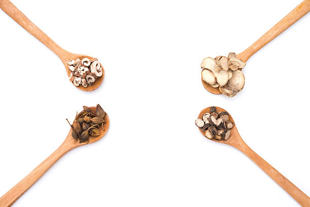 chinese herbs on wooden spoons at a white background - patchouli chinese medicine shiso chinese culture 個照片及圖片檔