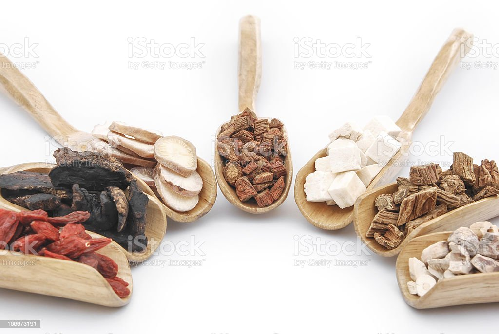 chinese herbs on wooden spoons royalty-free stock photo