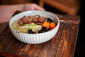 Chinese homemade noodles: soup noodles with sausage,mushroom and broth