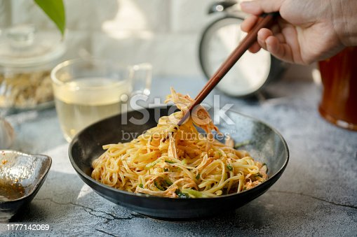 Chinese homemade noodles:spicy noodles stirred with shredded chicken meat