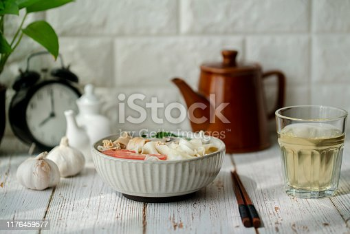 Chinese homemade soup noodles: tomato,mushroom and vegetables