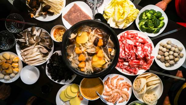 chinese hot pot - reunion stock photos and pictures