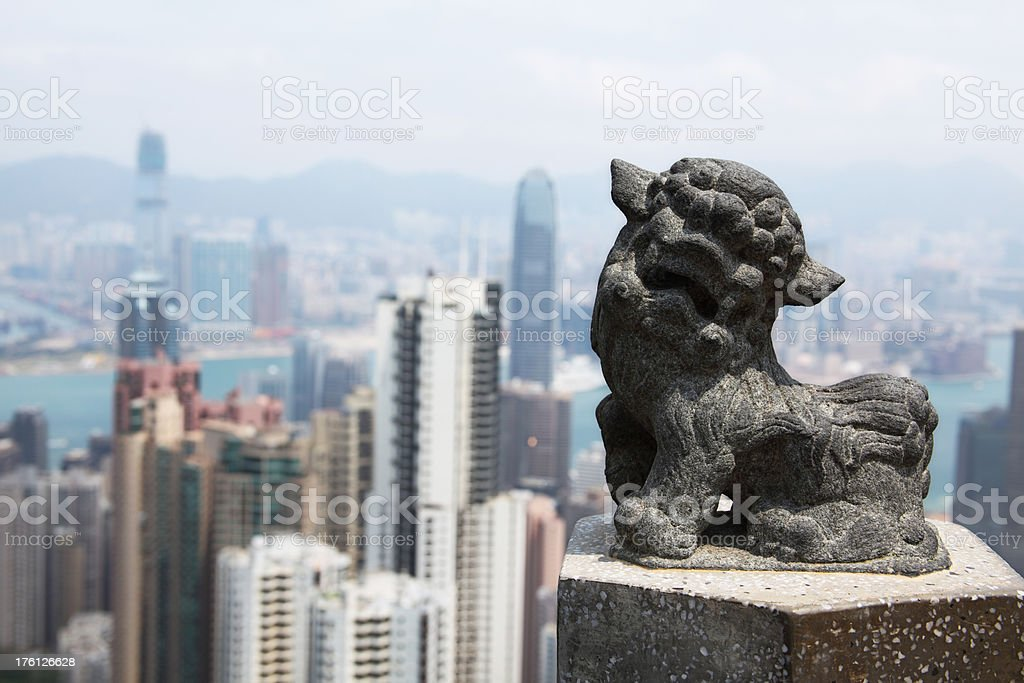 Chinese imperial lion with Hongkong skyline in the background royalty-free stock photo