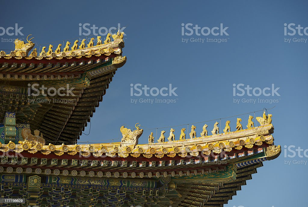 chinese imperial roof decoration in yellow glazed ceramic stock