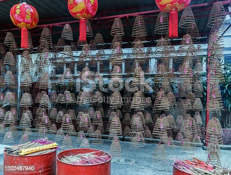 Chinese Incense Coil for Worship. Chinese Popular Paper Lanterns. Colorful incense joss sticks Buddhist Temple Chinese New Year
