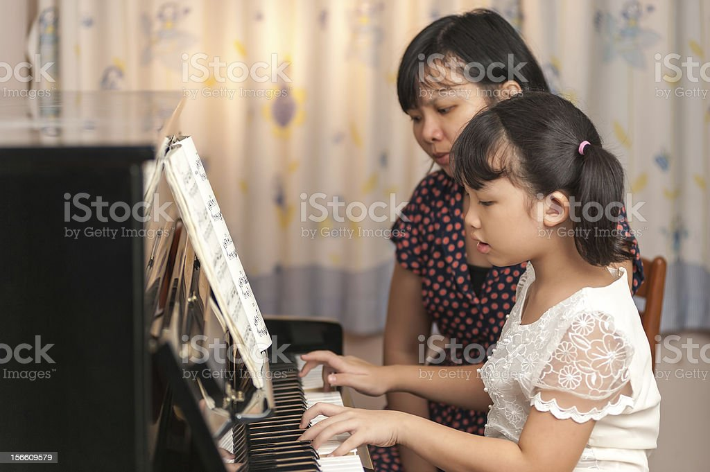 Chinese kid playing piano royalty-free stock photo