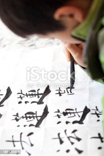 istock Chinese kid practice calligrapy 186434418