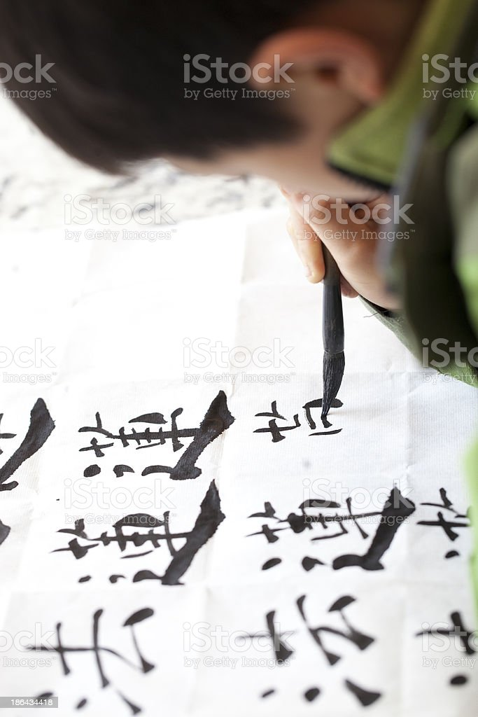 Chinese kid practice calligrapy stock photo