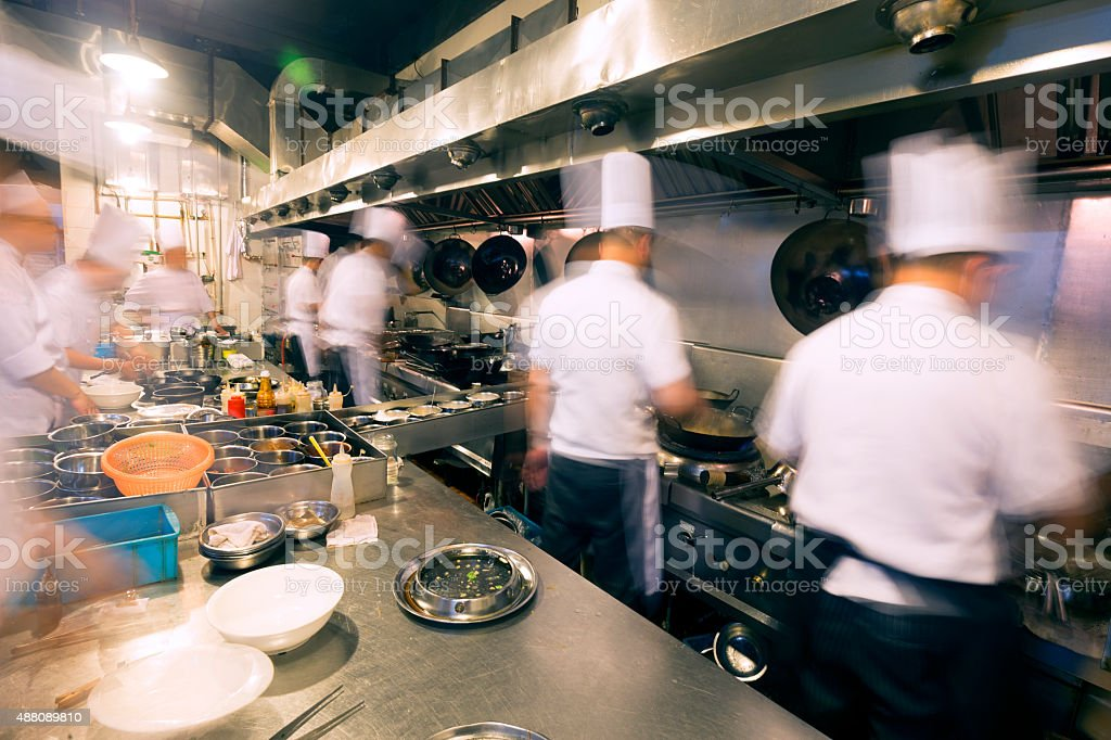 Chinese kitchen busy at work stock photo