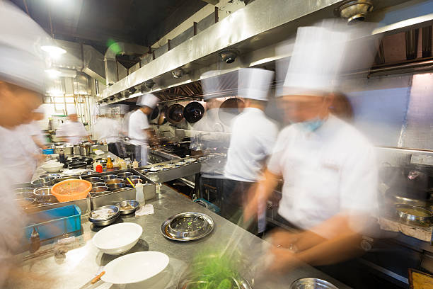 chinese kitchen busy at work - busy restaurant kitchen stock pictures, royalty-free photos & images