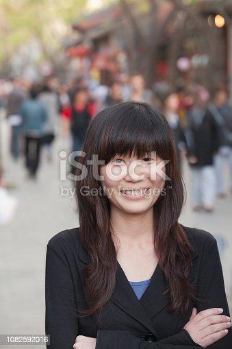 istock Chinese lady street portrait 1082592016
