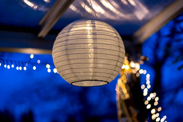 Chinese lantern hangs on a roof at night outside the house stock photo