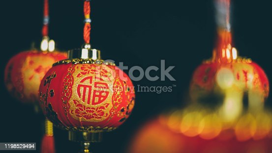 1176499937 istock photo Chinese lanterns on black background in china town.2020 Chinese New Year Rat zodiac sign.Chinese translate: Happy New Year 1198529494